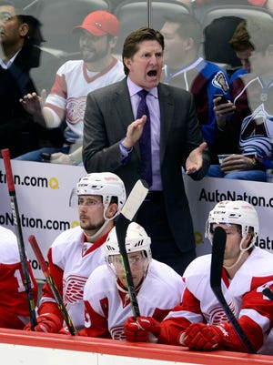 Detroit Red Wings coach Mike Babcock reacts on the bench against the Colorado Avalanche.