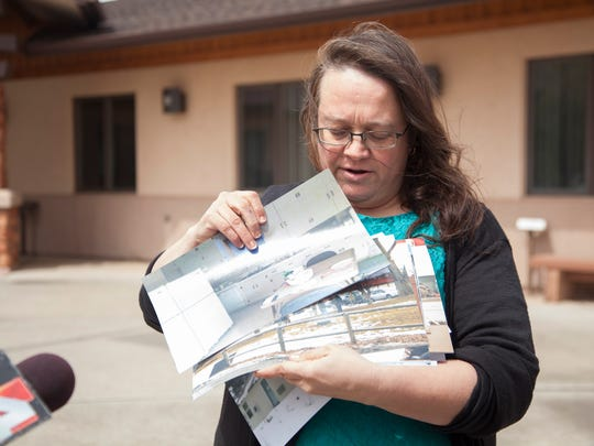 Sharla Christie speaks with members of the media concerning photos recently released by the U.S. Fish & Wildlife Service alleging extensive damage caused by occupiers of Malheur Tuesday, March 29, 2016.