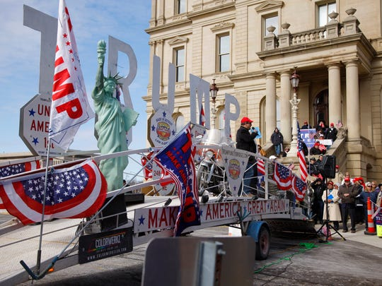 Trump supporters rally Saturday, March 4, 2017, at the state Capitol in Lansing.