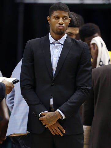 Pacers injured forward Paul George watches during a