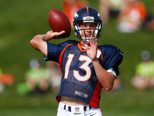 Denver Broncos quarterback Trevor Siemian throws a pass during an NFL football training camp, Saturday, Aug. 5, 2017, in Englewood, Colo. (AP Photo/David Zalubowski)
