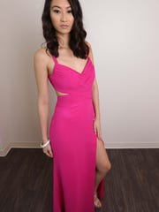 Model, Ruby Jiang wearing a hot pink cutout dress from Schaffer's ($150) and a bracelet from Soirée Couture ($45).
