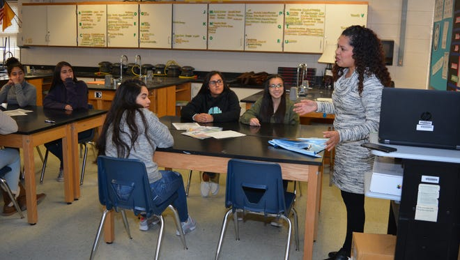 Santa Teresa High science teacher Monica Nuñez, right, tells students on Jan. 10, 2018 about her experiences during a recent expedition to Antarctica. Nuñez brought back a treasure trove of pictures, videos and data she plans to share with her students throughout the year.