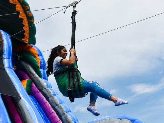 A zip line inflatable provided thrills for those more