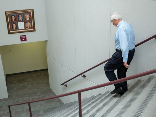 Garrey Carruthers, New Mexico State University's chancellor and president, walks down the stairs to the Regents room, where regents voted 4-0 to begin the search for a new chancellor. Wednesday Aug. 30, 2017.