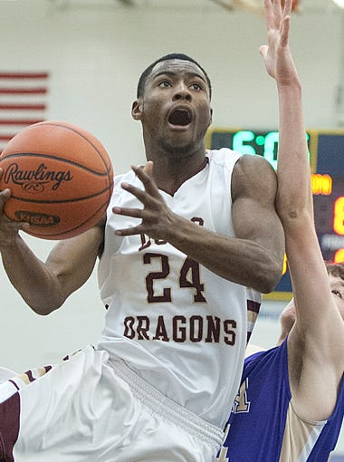 Doss Dragons guard-forward Terrell Gray drives to the