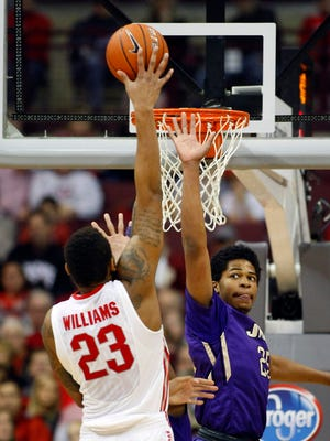 Ohio State Buckeyes center Amir Williams (23) goes in for two as James Madison forward Hari Hall (25) defends during first half action at Value City Arena. Ohio State won the game by a score of 73-56.