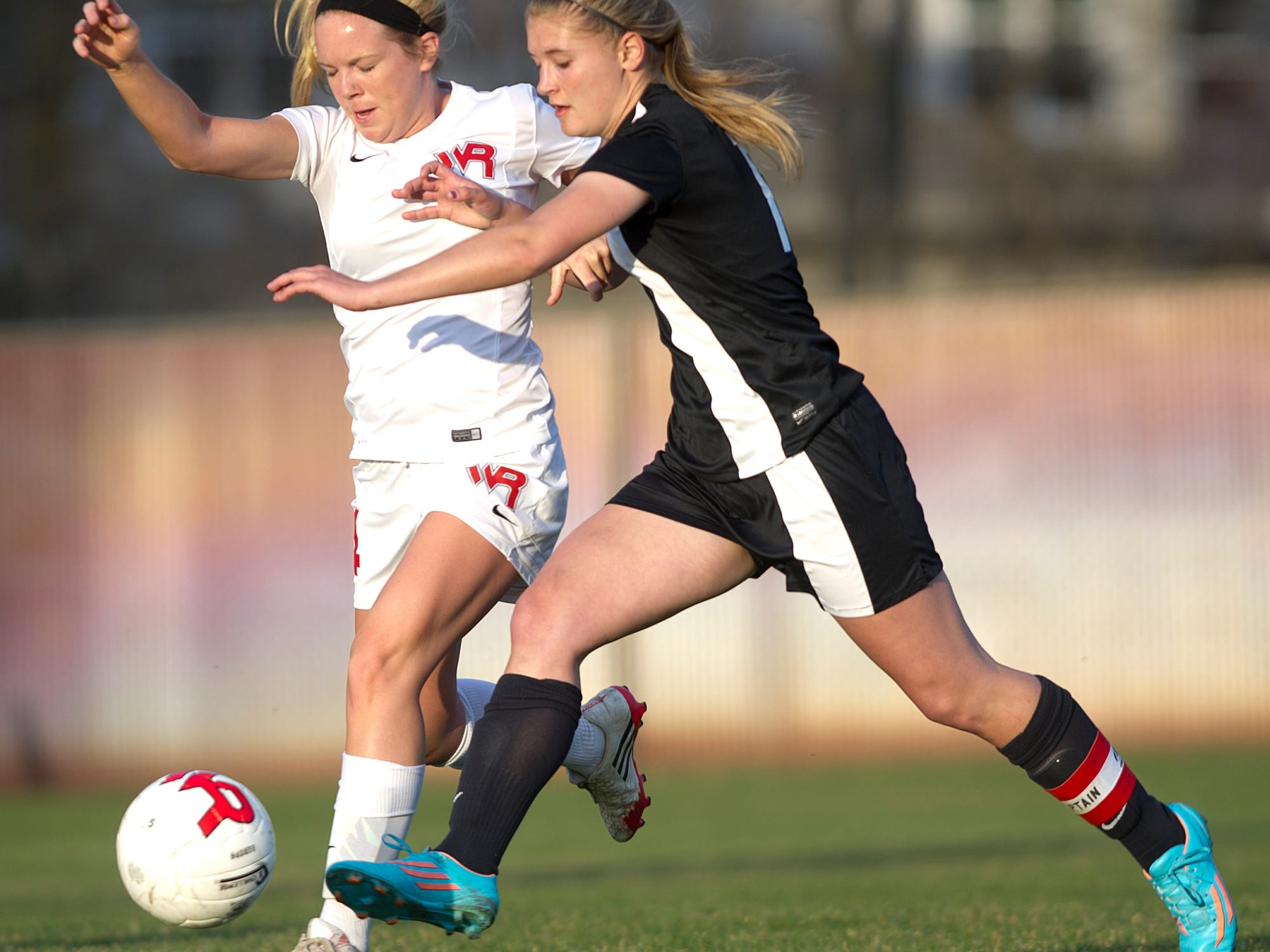 Wisconsin Rapids' Jaimie Vanderhei, left, battles Stevens Point Area Senior High's Abby Bohanski, right, for the ball during a Wisconsin Valley Conference soccer game Tuesday at Washington Field in Wisconsin Rapids.