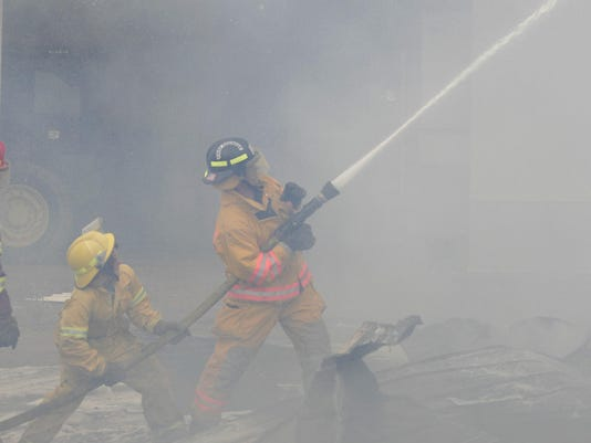 Wind-whipped fire destroys machine shed