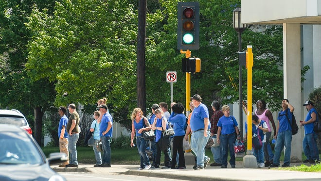 Employees leave Electrolux and cross 33rd Avenue North Monday, June 4, during an afternoon shift change in St. Cloud.