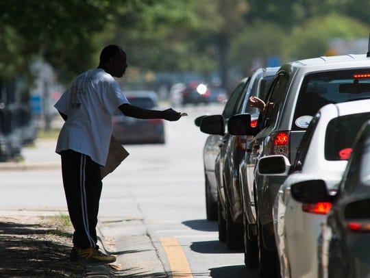 James McCorvey walks on the median near the intersection