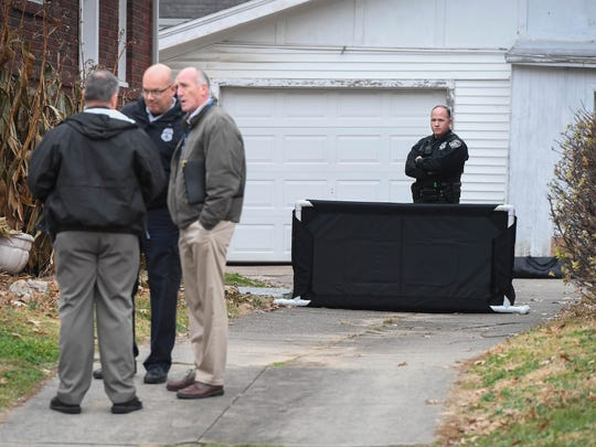 Evansville police officers investigate possible human remains found behind the home of Earl Martin at 906 Bellemeade Avenue Friday. The 38-year-old Martin was arrested Tuesday on preliminary charges of murder, robbery resulting in serious bodily injury, attempted murder with a firearm and kidnapping while hijacking a vehicle in connection with the death of Christopher Hoefling, 20, and shooting of Brandon Waldroup, 19, December 22, 2017.