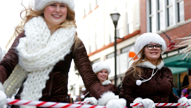 The Kickapoo High School Golden Girls perform during this year's Christmas Parade in downtown Springfield, Mo. on Dec. 10, 2016.