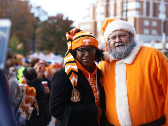 Tanya Johnson, mother of UT player Alexis Johnson, poses for a photo with Santa Vol before the Vol Walk outside Neyland Stadium.