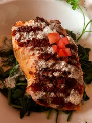 The crispy salmon at Scott's on Fifth is superb, with a crust of parmesan cheese, paprika and other bits.