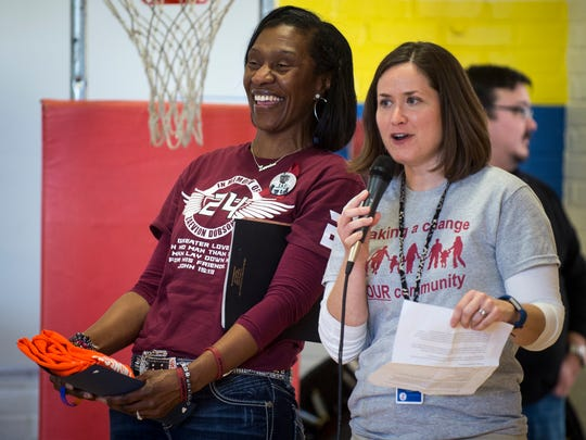 Zenobia Dobson, left, reacts to learning $1,144 was raised for the Zaevion Dobson Memorial Foundation during the first annual Zae Day Program held Tuesday at Lonsdale Elementary.