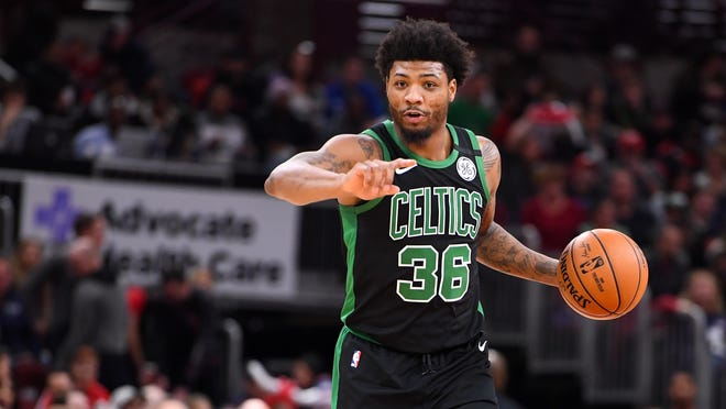 Boston Celtics guard Marcus Smart (36) dribbles the ball against the Chicago Bulls during the first quarter at the United Center on Jan. 4, 2020.