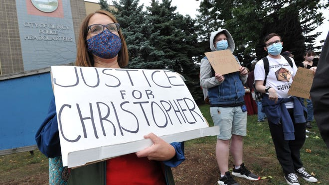 Sue Doherty of Quincy joins the Quincy for Transformative Change rally outside the Quincy police station seeking justice for Christpher Divens of Randolph who was struck by a Randolph police cruiser that is being investigated by Quincy police on Friday, Sept. 18, 2020. Tom Gorman/For The Patriot Ledger