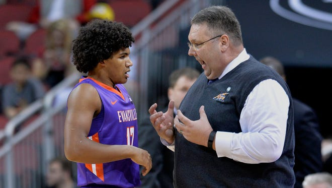Evansville's head coach Marty Simmons talks to Dru Smith during the first half of an NCAA college basketball game against Louisville, Friday, Nov. 11, 2016, in Louisville Ky.