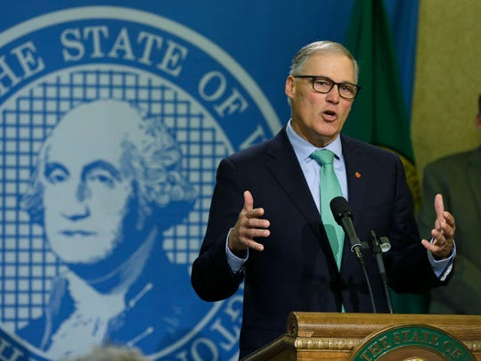 Gov. Jay Inslee talks to reporters about his proposed budget Wednesday in Olympia. While the bulk of Inslee's proposal focuses on education funding, his two-year plan also seeks more money for mental health and a tuition freeze for universities and community and technical colleges.
