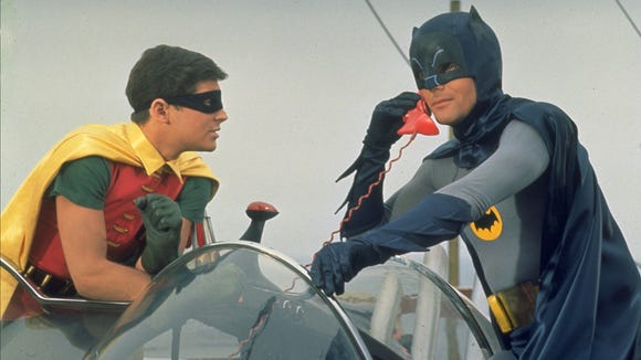 "Adam West's ""Light Knight"" (right, with Burt Ward as Robin) made the jump from the small screen to the big one with ""Batman: The Movie."""