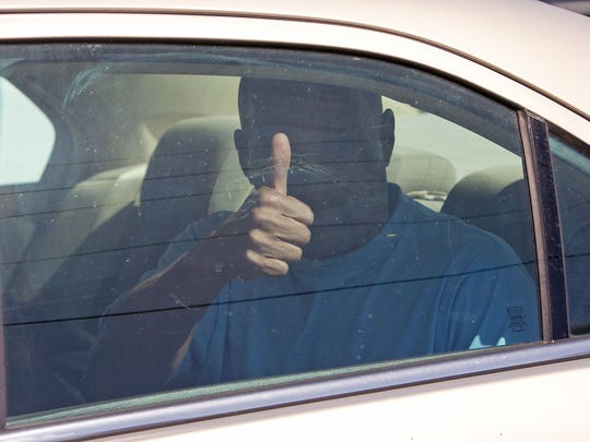 Louis Taylor gives the thumbs-up after being released from the Arizona State Prison in Tucson on Tuesday, April 2, 2013.