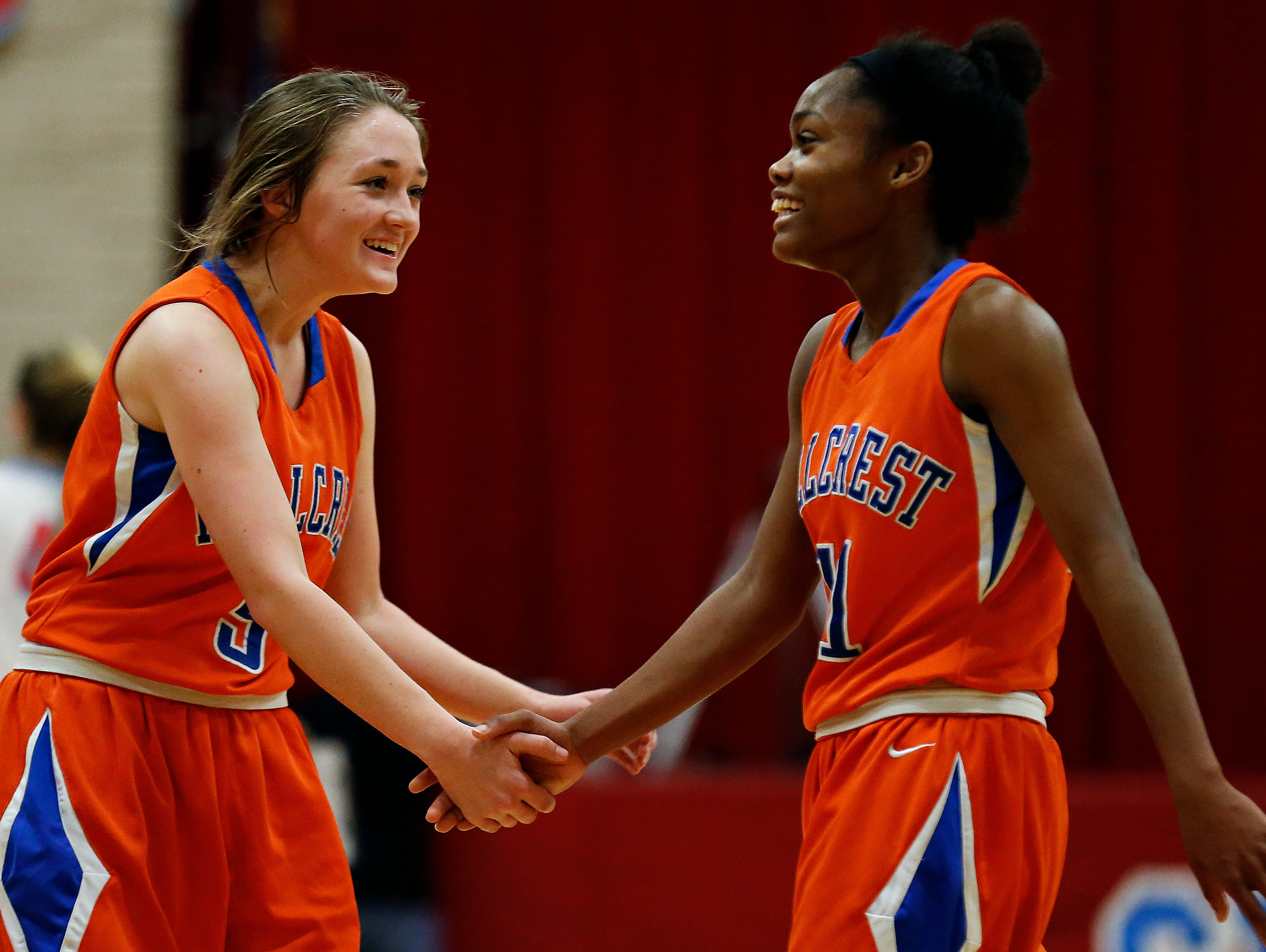 Hillcrest High Schoolsophomore Sarah Hale (5) and senior Kaycee Gerald (11) celebrate after the end of the Hornets' game against Glendale High School at Glendale High School in Springfield, Mo. on Jan. 7, 2015. The Hornets won the game 49-39.