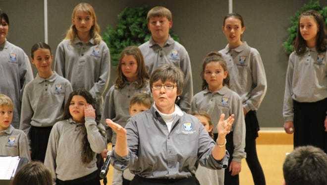 Cynthia Stevens directs the Great Falls College Community Choir during a holiday concert in December.