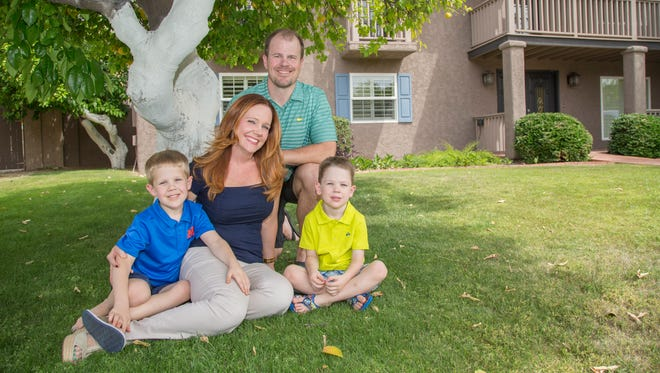Charlotte and John Shaff with their boys Jake (left) and Eric at their new home in Phoenix on April 11, 2015.