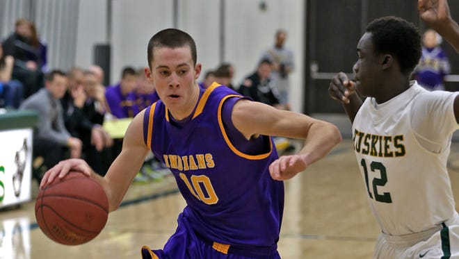 Indianola's Casey Krapfl, left, made a move toward the basket against Hoover in a February game. The schools are considering a move away from the CIML.