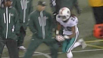Sean Combs' fellow combatant Sal Alosi, in action against the Miami Dolphins.