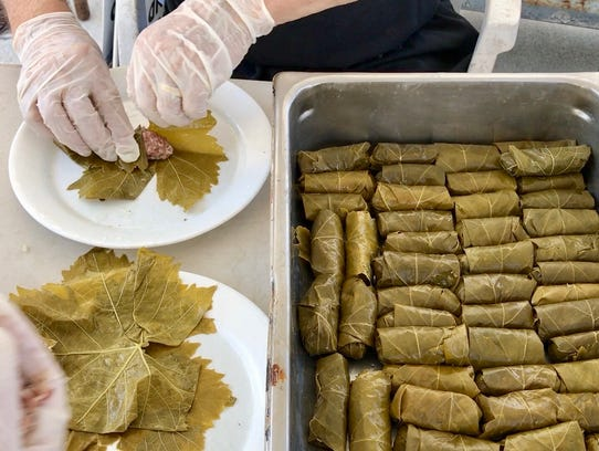 More than 10,000 dolmathes (stuffed grape leaves) will