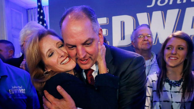 Louisiana Gov.-elect John Bel Edwards hugs his wife Donna Edwards as he arrives to greet supporters  in New Orleans, on Saturday.