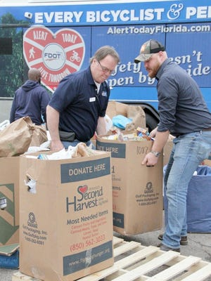 The city collected more than 3,0000 pounds of perishable food for Second Harvest during the Stuff the Bus event