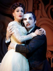 "Meghan Picerno (Christine Daaé) and Bronson Norris Murphy (The Phantom) star in ""Love Never Dies,"" the sequel to ""The Phantom of the Opera."" The musical debuted in Memphis Tuesday, Sept. 4, 2018. (Photographer: Joan Marcus)"