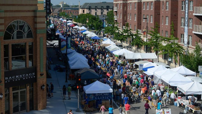 The Saturday Farmers Market draws up to 10,000 people to downtown Green Bay's South Washington Street.