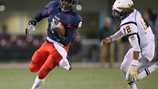 South Panola's Darrell Henderson (8) rouns the corner on Oak Grove's J.C. Keys (12) South Panola played Oak Grove in the Class 6A MHSAA Football Championships on Sunday Dec. 7, 2014 at Davis Wade Stadium in Starkville. Photo by Keith Warren