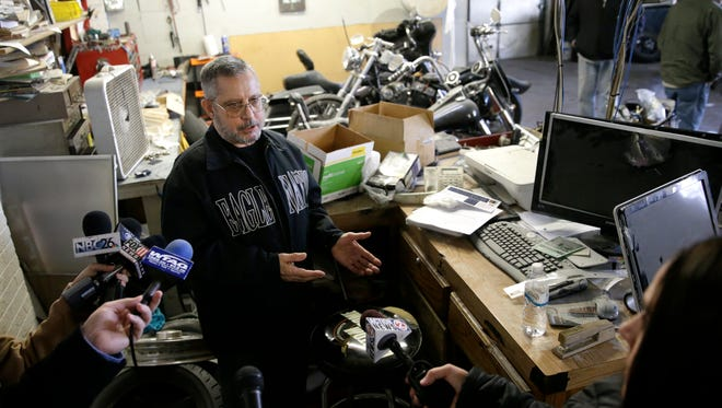 Steve Erato, owner of Eagle Nation Cycles in Neenah, speaks Wednesday about the hostage standoff that took place on Saturday.