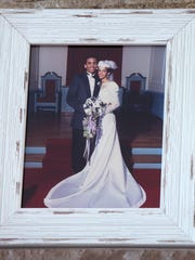 A photo of Christopher Smitherman, 50, and his wife, Pamela, 46, from their wedding sits on the mantle in their North Avondale home.