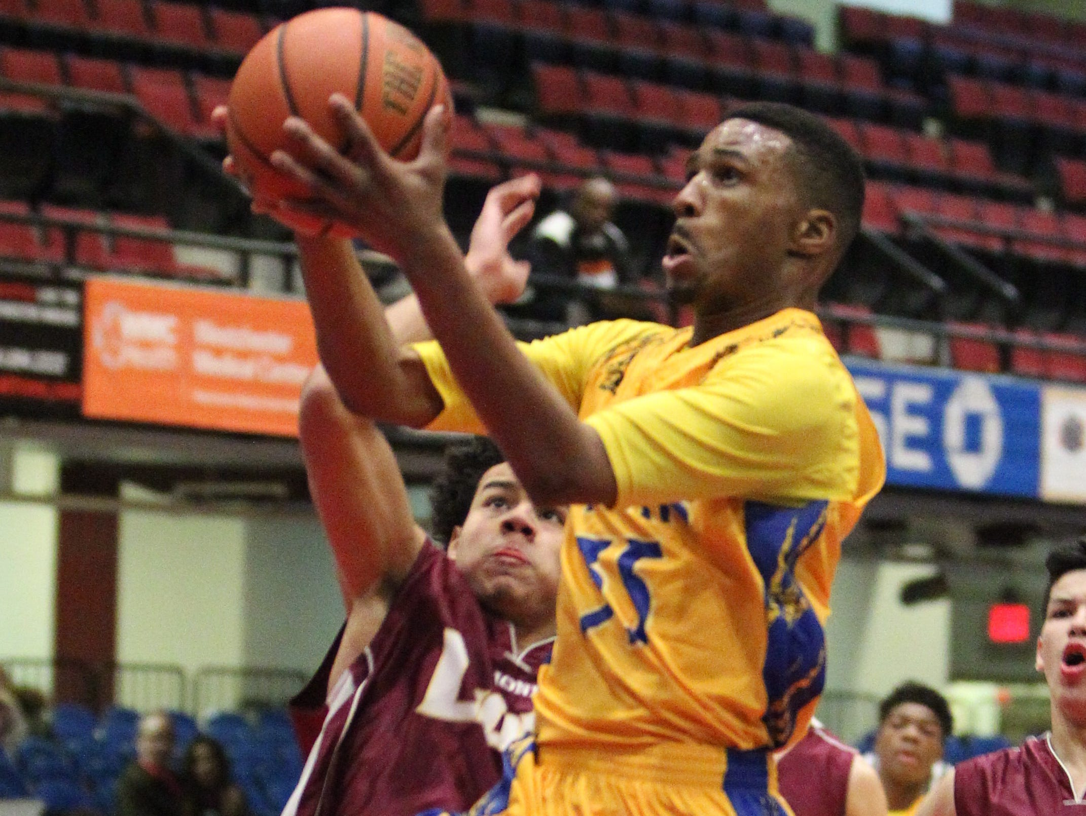 Martin Luther King's Ronald Toney shoots under pressure from Biondi's Giovanni Lozado during their Section 1 Class D semifinal at the Westchester County Center Feb. 19, 2016.