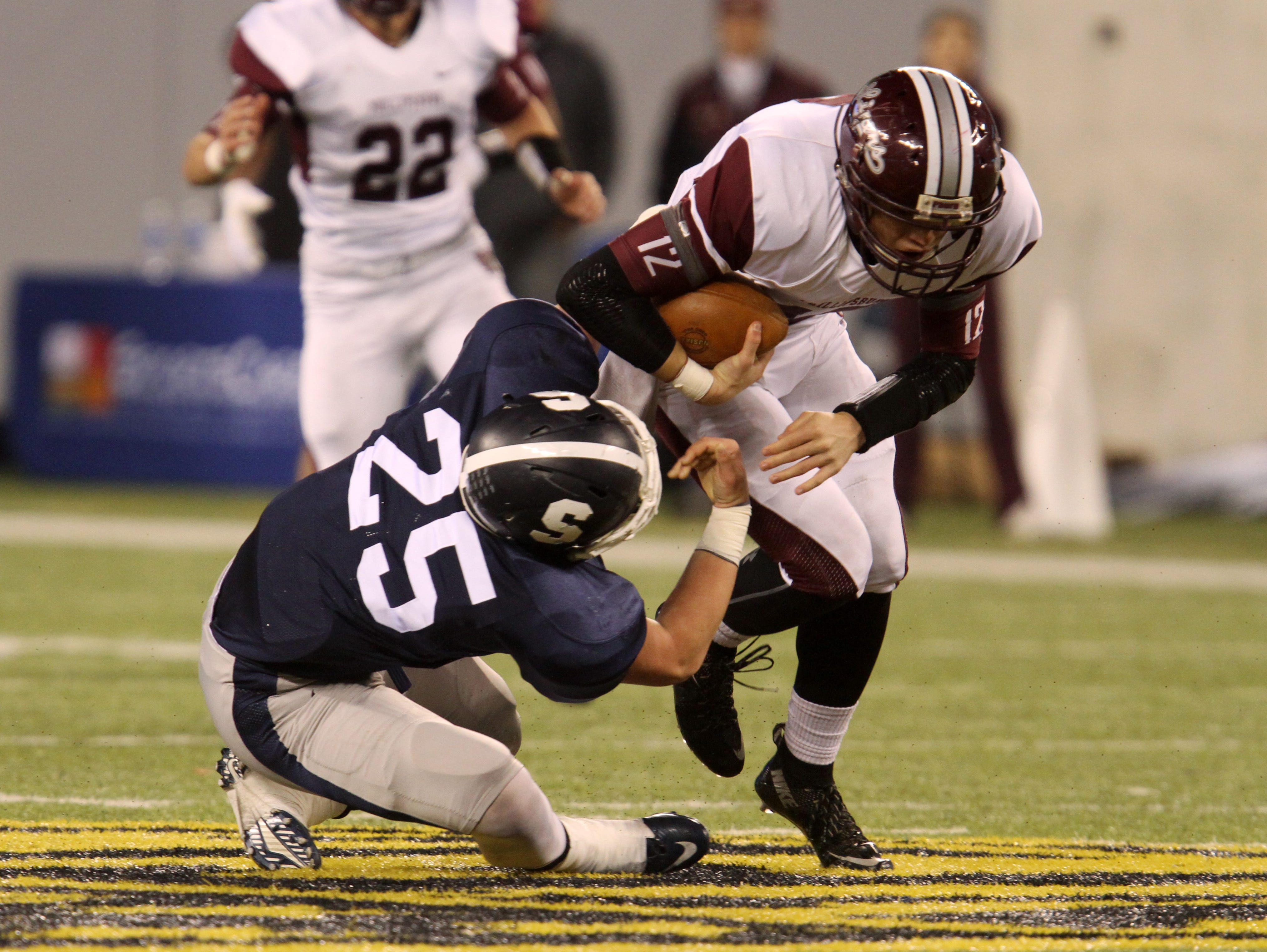 Middletown South's #25 Kevin Higgins tries to tackle Phillipsburg's QB #12 Danny Fisher in the first quarter during the North 2 Group IV game of the 2015 NJSIAA/MetLife Stadium High School Football Championships at MetLife Stadium in East Rutherford, NJ Saturday December 5, 2015.