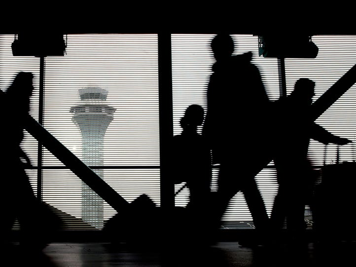 Travelers walk through Terminal 3 at Chicago's O'Hare