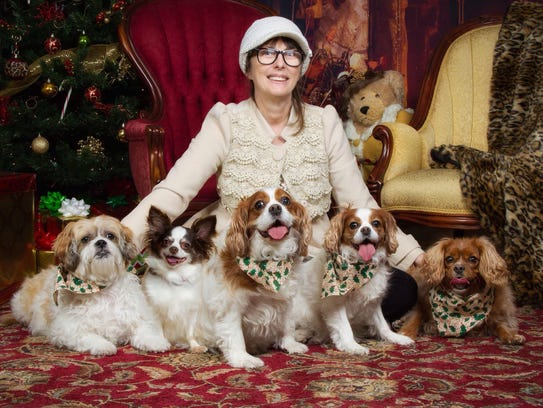 Peggy Lykens-Ruh with her five dogs