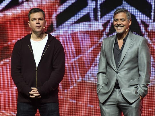 Matt Damon (left) and George Clooney double-teamed