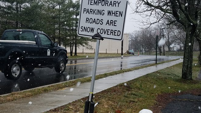 Raritan prepares for snow by opening temporary parking on Orlando Drive.
