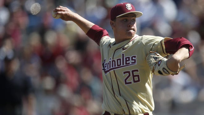 FSU's Cole Sands pitches during the third game of their series against Rhode Island at Dick Howser Stadium on Sunday.