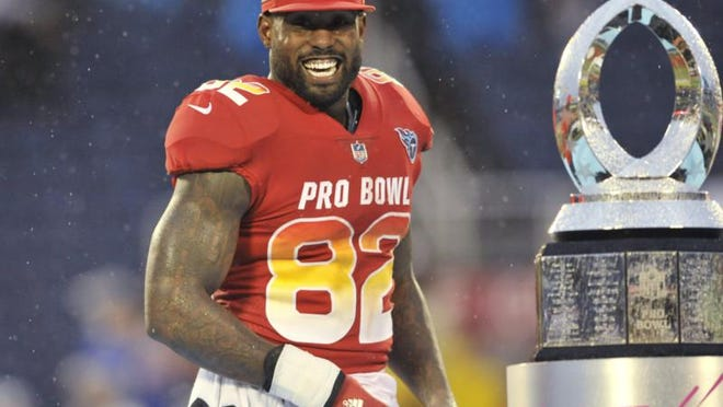 AFC tight end Delanie Walker (82), of the Tennessee Titans, smiles after winning the MVP Offensive Player of the game, at the NFL Pro Bowl football game, Sunday, Jan. 28, 2018, in Orlando, Fla. The AFC defeated the NFC 24-23.