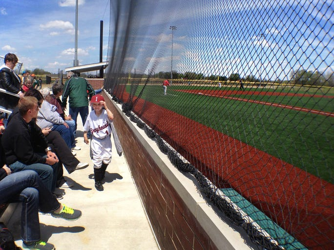Six-year-old Owen Mahan, Pittsboro,got to go on the field and in the dugout with the UIndy team before and after games, such as the Greyhounds' game against the University of Southern Indiana at Westfield's Grand Park on May 3, 2014.