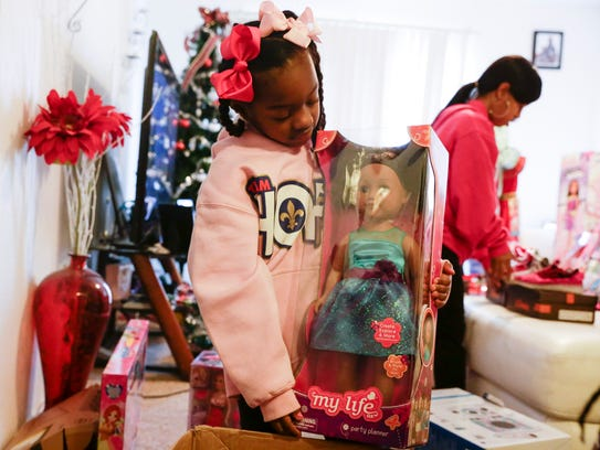 Ke'ani Page open Christmas gifts she received after