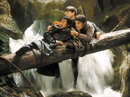 """Corey Feldman, right, played the talkative Mouth in the 1985 cult hit """"The Goonies."""" Mouth and a group of friends, including Data (Jonathan Ke Quan) and Mikey (Sean Astin) went in search of lost pirate treasure in hopes of saving their parents' homes from demolition."""